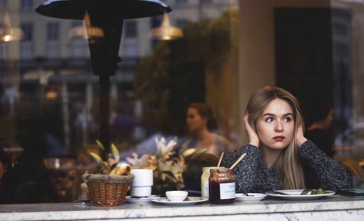 Woman wondering if she should freeze her eggs while staring out the window