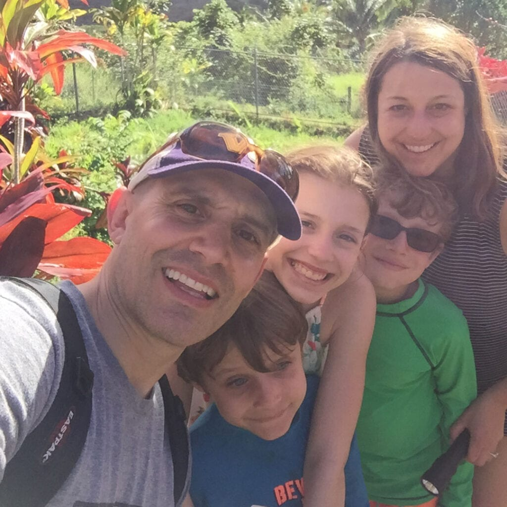 Dr. Amy Criniti, Bellevue fertility specialist, with husband and 3 kids in yard