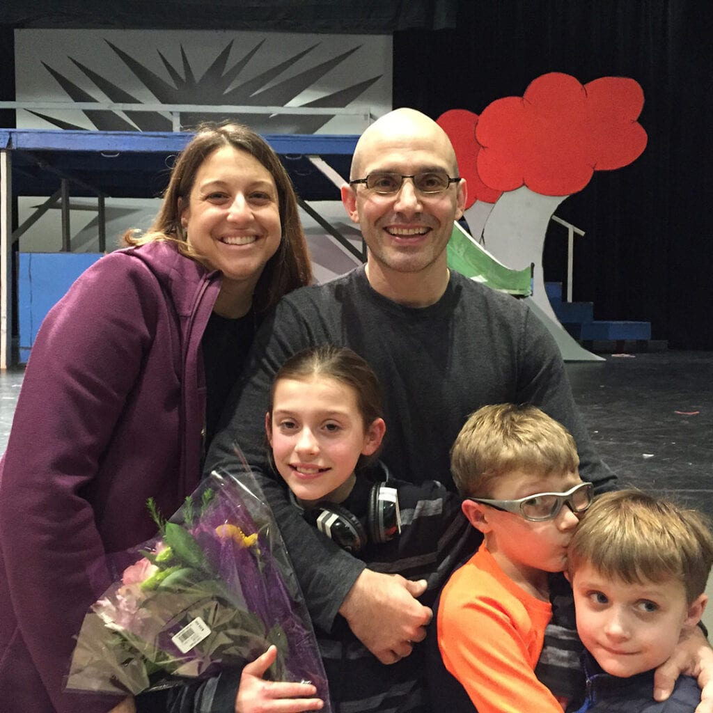Dr. Amy Criniti, Bellevue fertility specialist, with husband and 3 kids