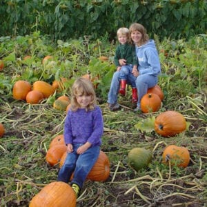 parent with fertility medicine history with kids at pumpkin patch