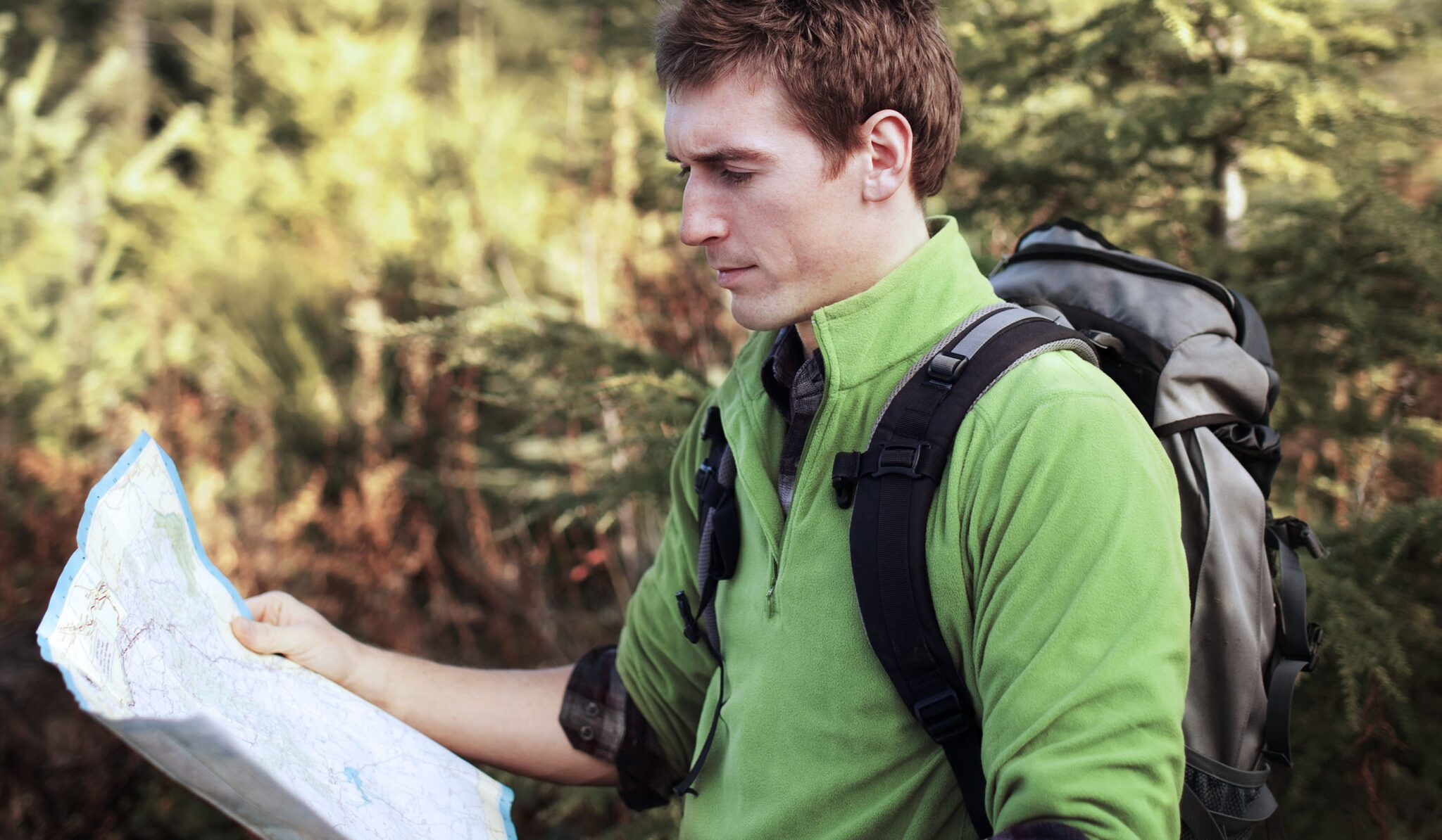 man in infertility treatment hiking with map